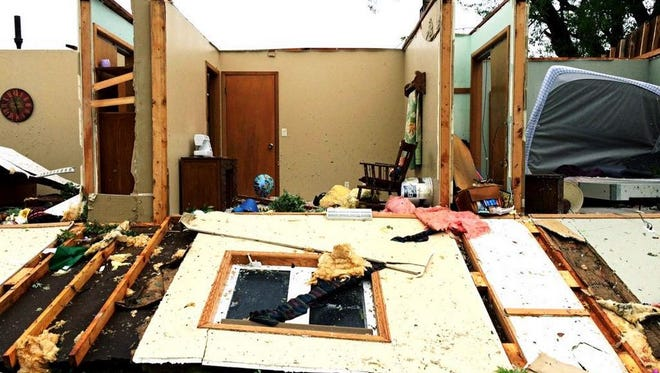 A damaged home east of Garretson, S.D., after severe weather Monday morning.
