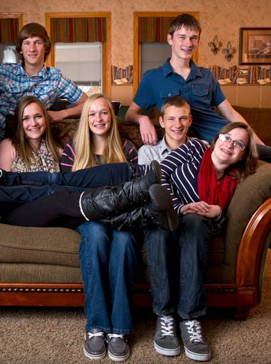 McCaughey septuplets of Carlisle, Iowa, photographed at their home Wednesday Nov. 13, 2013.