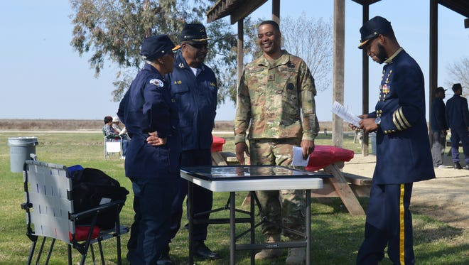 L.D. Slade, left, A.W. Lee, second from left, talk with Cornell Herrington, Army 1st Sgt. and Tavon Kyle during a Black History Month event on Saturday at Allensworth State Park.