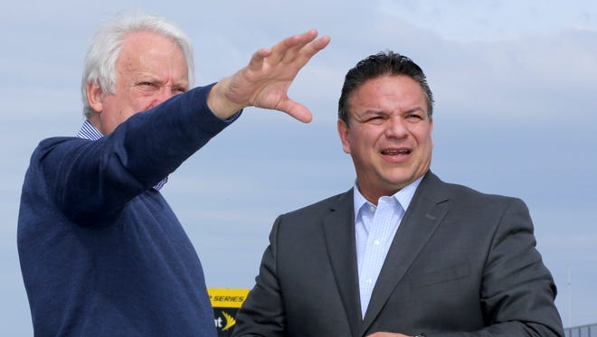FIA Technical Director Charlie Whiting (left) explains something to Watkins Glen International President Michael Printup on the front stretch after Whiting inspected the track on Tuesday. WGI/Bob Magee