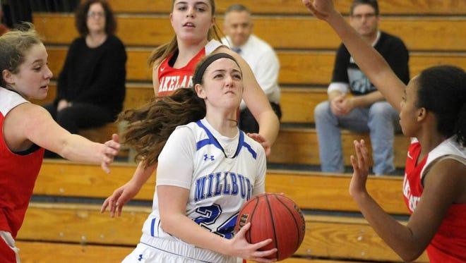Senior Kayla Wolf drives to the basket against Lakeland.