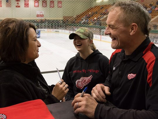 Darren McCarty enteracts with a fan Thursday night