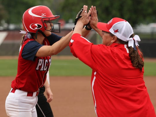 Pacelli High School's Paige Hintz is congratulated by Cardinals coach Ann Molski during a WIAA Division 4 state semifinal game in June. Hintz was one of two Pacelli players recently named to the all-Central Wisconsin Conference-8 softball first team.