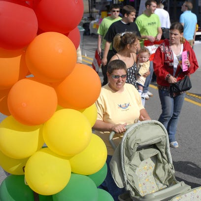 Attendees of the 2009 OUTfest walk down Main Street