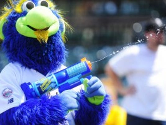 York Revolution mascot DownTown shoots a water gun at York Revolution's game against the Bridgeport Bluefish July 18. Summer reading club participants who read more than 800 minutes can snag a free ticket to the Revolution's Aug. 21 game. (YORK DAILY RECORD/SUNDAY NEWS -- FILE)