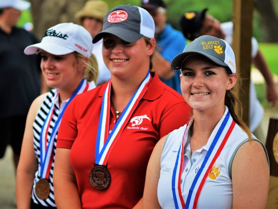 Blanket's Marki Kinkade (far right) poses with her gold medal next to Richards' Skylar Mast (center, second place) and Fort Elliott's Shaley Goad following the final round of the UIL Class 1A golf tournament in 2017.
