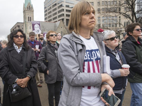 Kit Malone (foreground), Indianapolis, stands with others at a rally for inclusion, Monument Circle, Indianapolis, Friday, January 20, 2017. The rally, involving about 250 people, was called to coincide with the inauguration of Donald Trump as the nation's 45th President.