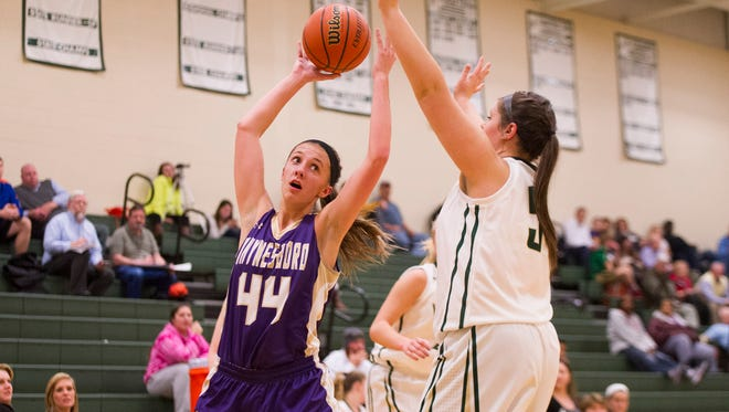 Waynesboro's Allie Coburn struggles to hold onto a deflected pass during their basketball game against Wilson Memorial on Thursday, Dec. 11, 2014.