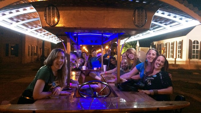 Raela and friends enjoy a night out on the Pensacola Pedal Trolley.