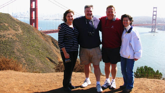 Debbie Maggard, Virgil Malone, and Dave and Shirley Hudgens stand in front of the Golden Gate Bridge in San Francisco.