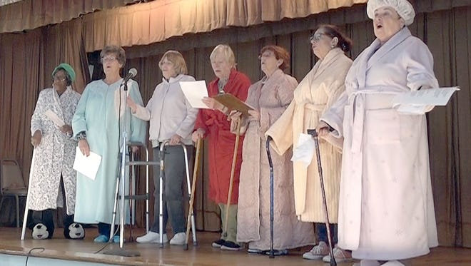 "(From left) Annie Mae Jefers, Barbara Robinson, Ann Starkey, Doris Schalick, Nancy Steelman, Eva Prestopino and Norene Ritter, members of the Woman's Club of Vineland, perform a parody of ""These Are a Few of My Favorite Things"" during the Southern District Performing Arts Day on March 28."