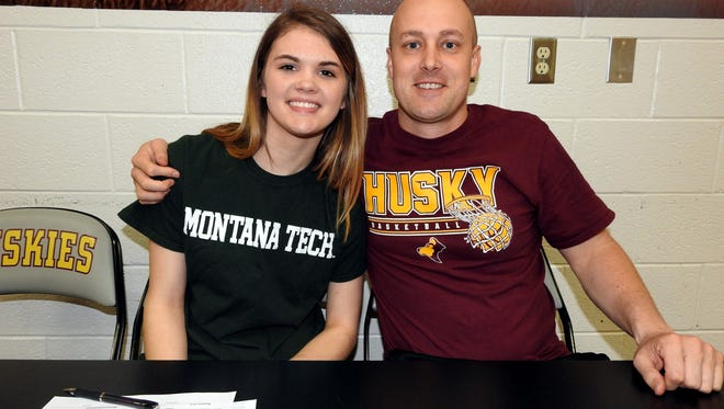 Belt's Dani Urick, pictured with Huskies' head coach Jeff Graham, signed with the Montana Tech women's basketball team on Wednesday.
