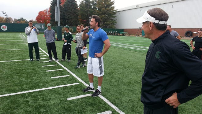 This photo provided by the MSU Athletic Communications department shows Ben Affleck speaking to the MSU football team.