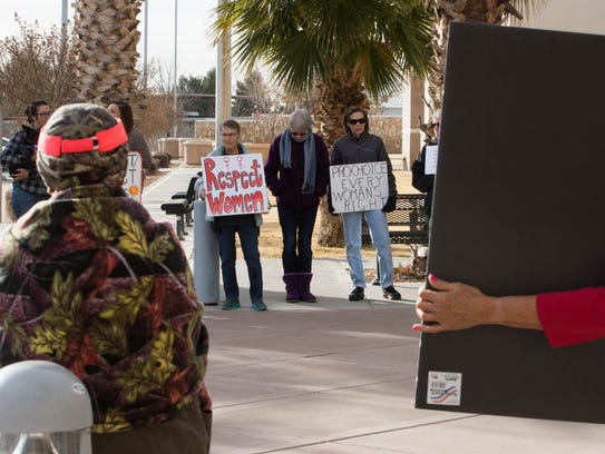 Protesters lined the entryway to the Doña Ana County Government Center on Tuesday to voice concerns about John Vasquez and his treatment of woman. Feb 13, 2018