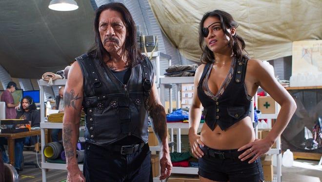 Danny Trejo and Michelle Rodriguez return to dole out vigilante justice in 'Machete Kills.'