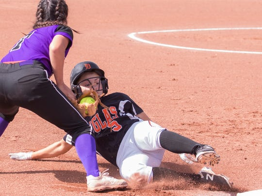 Douglas runner Jasmine McNinch is tagged out at third by Spanish Springs shortstop Courtney Huff in the 2018 NIAA 4A Softball Championship game at Manogue on Saturday