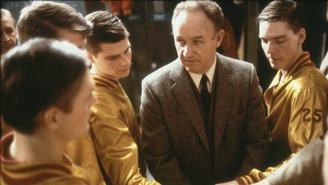 """Actor Gene Hackman, as coach Norman Dale, prepares to send players out onto the court in the 1986 movie """"Hoosiers."""""""