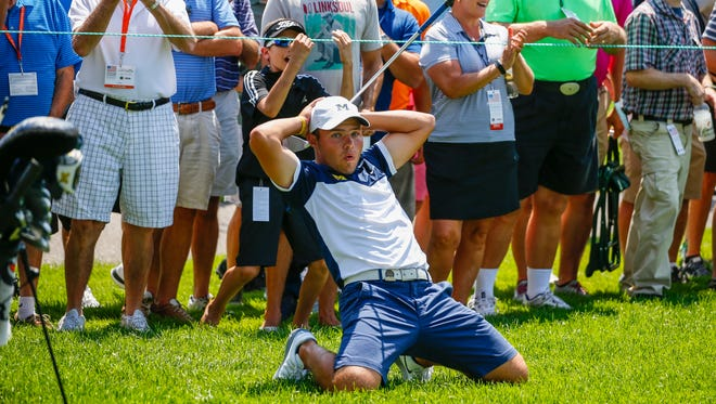 Nick Carlson reacts to his pitch shot on the second hole during quarterfinal round of match play at the 2016 U.S. Amateur Friday at Oakland Hills Country Club.