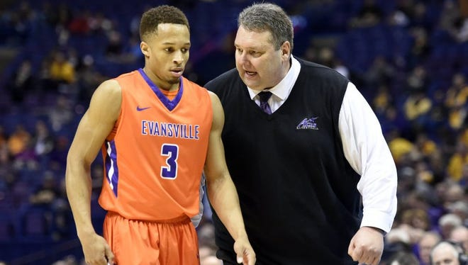 University of Evansville head coach Marty Simmons speaks to Jaylon Brown during the second half of the Missouri Valley Conference championship at the Scottrade Center in St. Louis in March. Brown enters 2016-17 as the Aces' lone returning starter from last season.