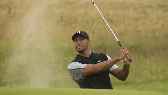 Tiger Woods plays a shot from the bunker near the 15th green during a practice round Saturday at Royal Liverpool Golf Club.  AP Tiger Woods of the US plays a shot from the bunker near the 15th green during a practice round at Royal Liverpool Golf Club prior to the start of the British Open Golf Championship, in Hoylake, England, Saturday, July 12, 2014. The 2014 Open Championship starts on Thursday July 17. (AP Photo/Jon Super)