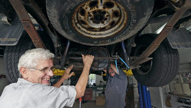 Shep DeShaney, left, jokes with Mike McCoy as they work on removing a gas tank on Aug. 31 at Grishaber Service Garage in Appleton. It is Shep's 60th year working at the shop. He has been working with Mike for 30 years.