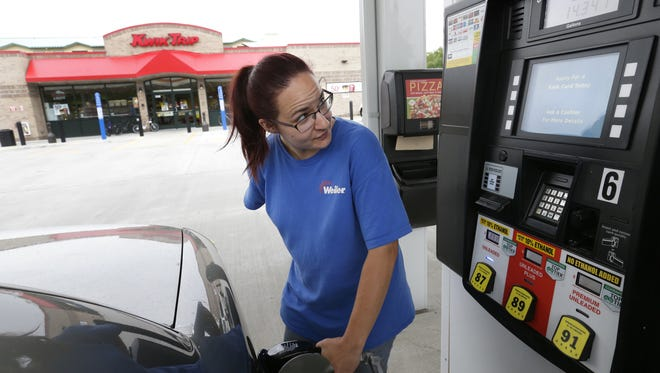 Kwik Trip was named by readers as the cleanest gas station. Here, Katie Smith of Appleton fills her car at Kwik Trip on Richmond Street in Appleton.