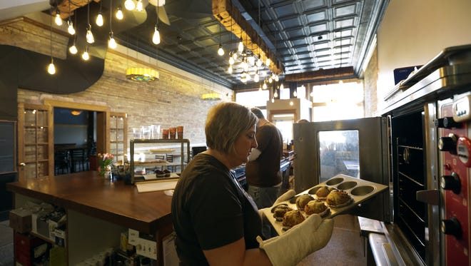 Owner Laura Loukidis bakes fresh banana nut, blueberry and double chocolate muffins at Lou's Brew Cafe in downtown Appleton.