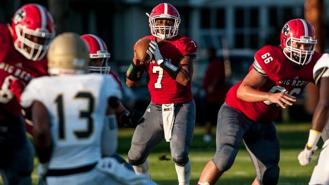 Port Huron senior DeAngielo Sanderson Jr. looks for an open receiver during a football game Friday, August 26, 2016 at Port Huron High School's Memorial Stadium.