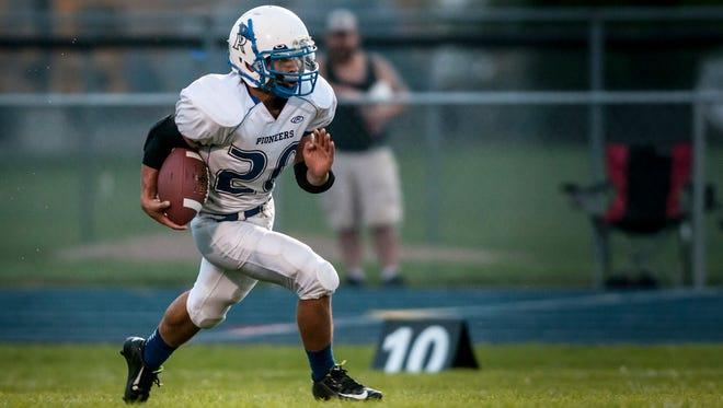 Cros-Lex's Joe Hayden returns the ball during a football game Friday, September 9, 2016 at Richmond High School.