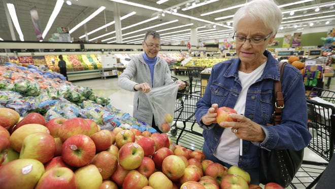 Kathy Collins, left, of Appleton and Donna Christie of Sherwood shop for produce at Festival Foods on Van Roy Road in Appleton.