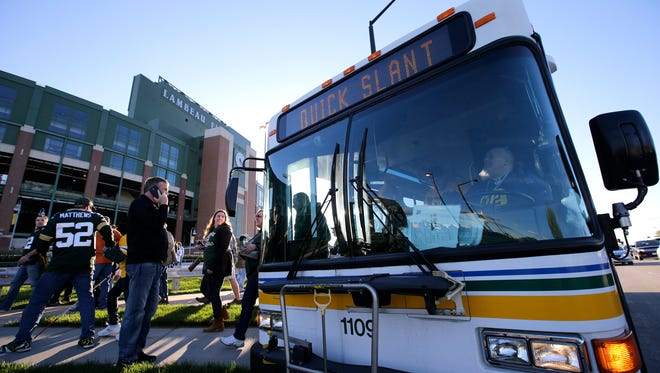 A Green Bay Metro Transit bus drops off fans along Lombardi Avenue before the Green Bay Packers game against the New York Giants Sunday, October 9, 2016, at Lambeau Field in Green Bay, Wisconsin.