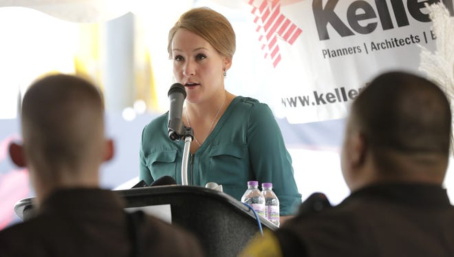 Stephanie Wiener, a police officer with the Appleton Police Department, talks about her May 28 attack by theft suspect Marcus D. Felton and the impact community support has had on her Friday, Oct. 14, 2016, during a dedication to police personnel event at Keller-Planners, Architects and Builders in Kaukauna, Wisconsin.