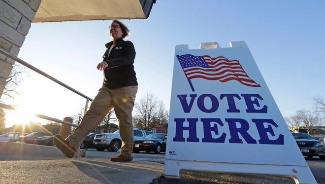 Nov 8, 2016; Appleton, WI, USA;  Citizens arrive early to vote in the presidential election at Memorial Presbyterian Church. Mandatory Credit: Dan Powers/The Post-Crescent via USA TODAY NETWORK
