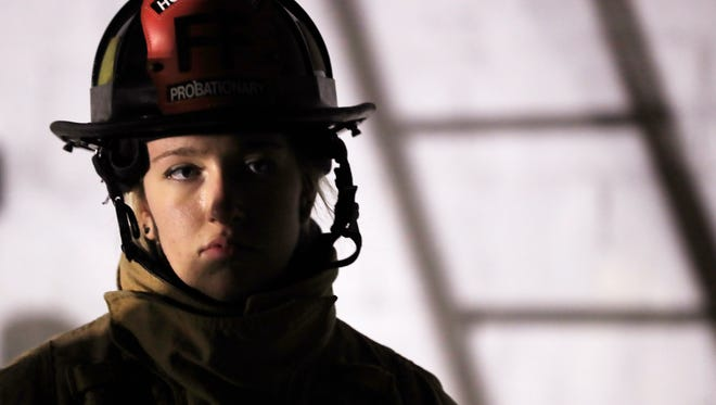 Probationary firefighter Sam Hackl listens to instructions Tuesday during a training exercise in Howard.