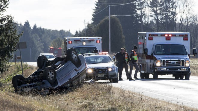 A car flipped over on the side of County Road LS near County Road C in Newton Dec. 8.