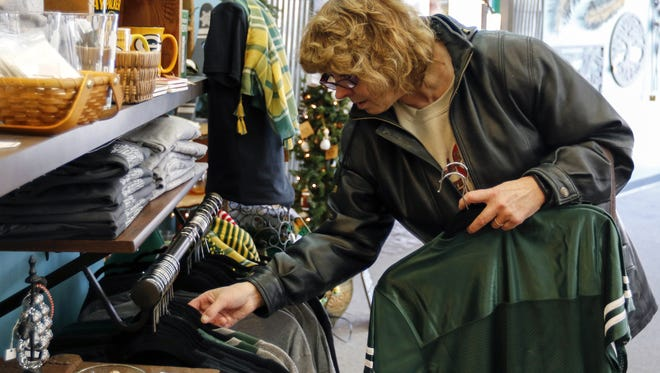 Sally Paral does some Christmas shopping at Ivy Trails as local businesses prepare for their busiest weekend since Black Friday in Manitowoc Dec. 13.