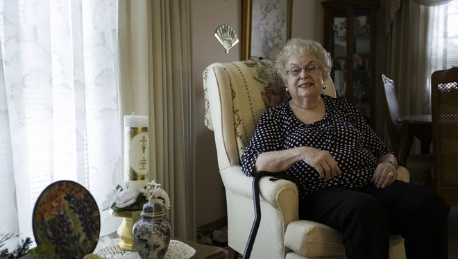 Shirley Kelly in her home Friday, Dec. 23, in Newton. Kelly developed the Help the Handicap decal for local businesses that go out of their way to assist the disabled.