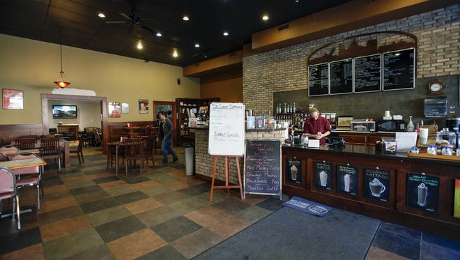 Manitowoc Coffee counter and seating area Wednesday, Jan. 18, in Manitowoc. The coffee shop will be closing its doors Jan. 31.