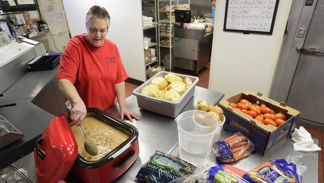 Employee Carol Hamilton prepares white chicken chili at Paradise Island Grill and Ice Cream in Appleton.