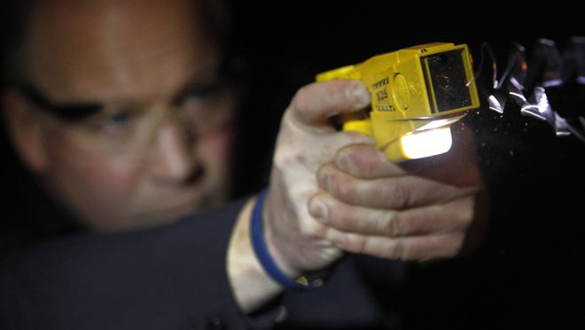 Lt. Todd Peters deploys a Taser International X26 in this 2012 file photo taken at the Appleton Police Department in Appleton, Wisconsin.