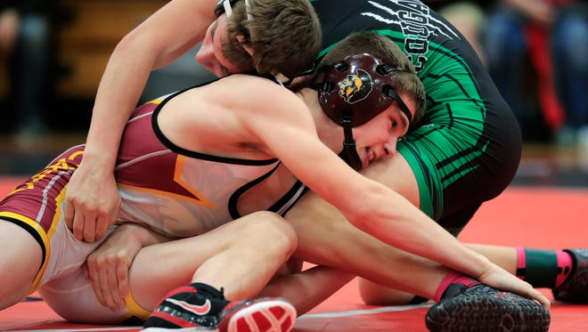 Luxemburg-Casco's Bryce Bosman wrestles Coleman's Caleb Gross in the 113-pound championship bout at the Pulaski Invite on Jan. 28. L-C and Coleman both won conference titles this season.