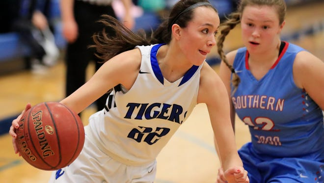 Wrightstown's Kailee Van Zeeland (22) dribbles past Southern Door's Tehya Bertrand during a Division 3 regional final in February 2017.