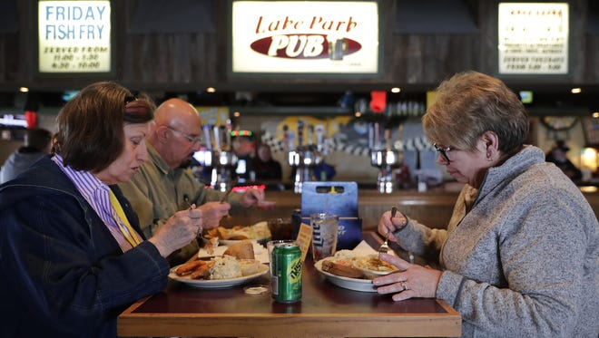 Pat Drephal, left, eats the battered cod while Nancy Bressers has the broiled haddock, both of which are lunch specials during Lent at Lake Park Pub in Menasha.