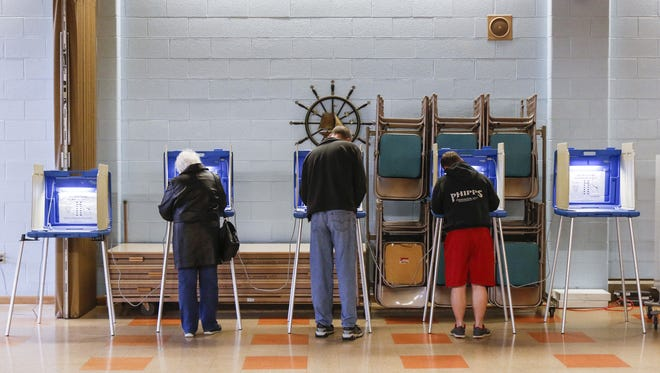 Voters mark their ballots in Manitowoc's 10th District.