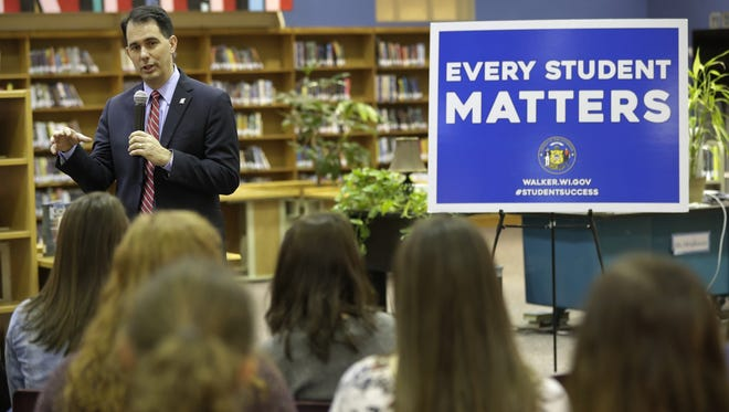 Gov. Scott Walker discusses measures impacting K12 education in his proposed state budget Thursday at Neenah High School.