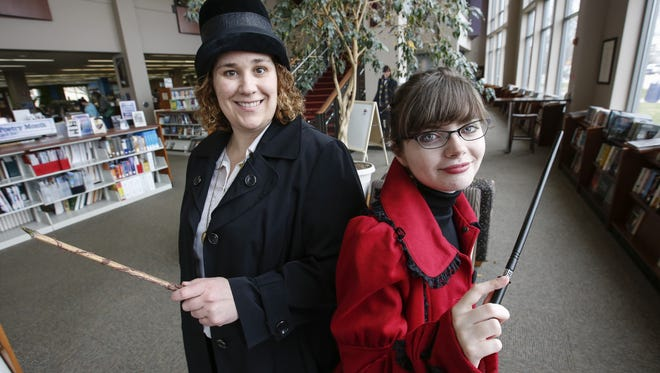 Meredith Meier, left, in dress as Porpentina Goldstein and Alex Coonce dressed as witch Alexandria Barleby pose for a photo in the Manitowoc Public Library Wednesday, April 19, in Manitowoc. The library is hosting the upcoming Wizarding World this Saturday from 9 a.m. to 1 p.m.