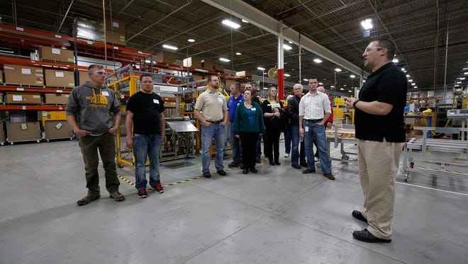 Orion Energy's Kelly Reif, right, leads the Chamber Young Professional's group on a tour of their facility during Young Professionals Week Tuesday, Apr. 25, 2017, in Manitowoc, Wis. Josh Clark/USA TODAY NETWORK-Wisconsin
