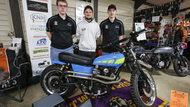 From left, Josh Brotski, Kyle Steinhauer and Alex Johnson of Two Rivers High School pose next to their team's mini-chopper at the 35th annual Northeastern Wisconsin motorcycle show April 29 in Manitowoc.