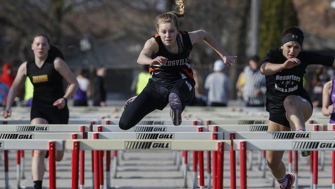 Reedsville's Faith Lubner takes the lead during the girls 100 meter hurdles at the Reedsville Track Invitational at Reedsville High School Thursday, Apr. 13, 2017, in Reedsville, Wis. Josh Clark/USA TODAY NETWORK-Wisconsin
