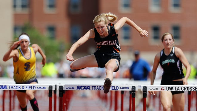 Faith Lubner of Reedsville High School jumps a hurdle in the D3 100 meter hurdles final on the last day of the WIAA state track and field meet at UW-La Crosse Veterans Memorial Field Sports Complex Saturday, Jun. 3, 2017, in La Crosse, Wis.